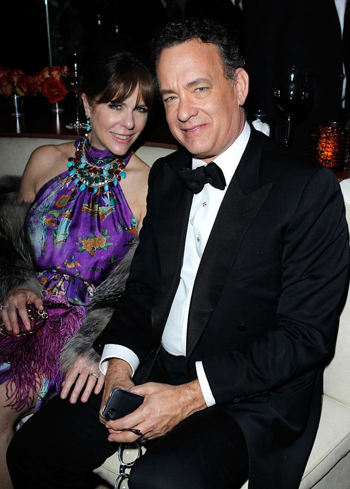 Two-time Oscar winner Tom Hanks should have been embarrassed to sit next to his wife, Rita Wilson, who wore one of her signature eyesores.