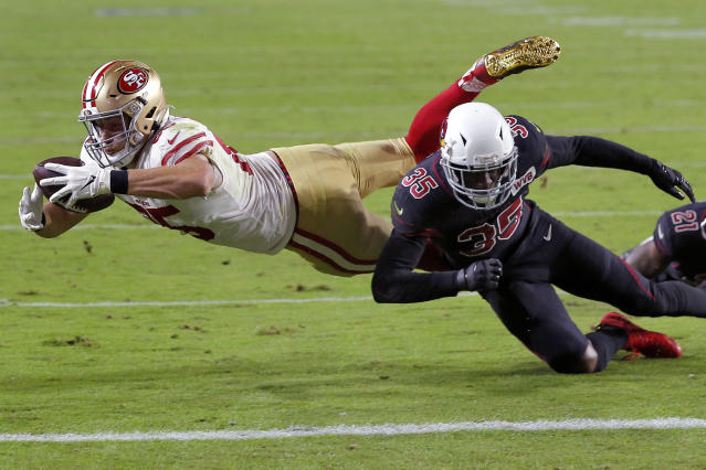 49ers tight end George Kittle (85) is tackled short of the goal line by Arizona Cardinals safety Deionte Thompson (35) on Halloween night in Glendale, Arizona. (AP Photo/Rick Scuteri)