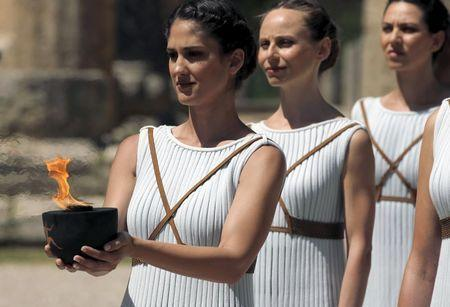A priestess carries the Olympic Flame during the dress rehearsal for the Olympic flame lighting ceremony for the Rio 2016 Olympic Games at the site of ancient Olympia in Greece, April 20, 2016. REUTERS/Yannis Behrakis