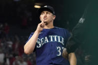 Seattle Mariners relief pitcher Paul Sewald gestures toward the crowd as he forces out Los Angeles Angels' Jose Rojas at first to end the baseball game Friday, Sept. 24, 2021, in Anaheim, Calif. The Mariners won 6-5. (AP Photo/Mark J. Terrill)