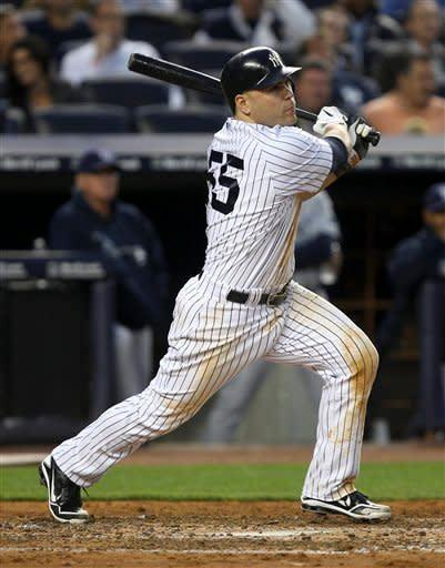 New York Yankees' Russell Martin hits a grand slam during the fourth inning of a baseball game against the Tampa Bay Rays at Yankee Stadium in New York, Tuesday, June 5, 2012. (AP Photo/Seth Wenig)
