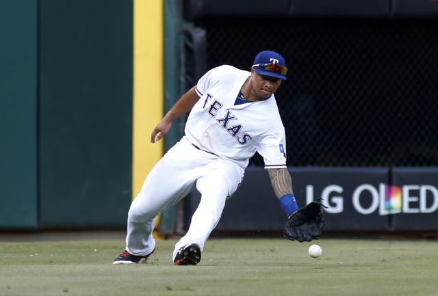 Texas Rangers left fielder Michael Choice can't catch a single by Baltimore Orioles' Nick Markakis during the third inning of a baseball game Tuesday, June 3, 2014, in Arlington, Texas. (AP Photo/Sharon Ellman)