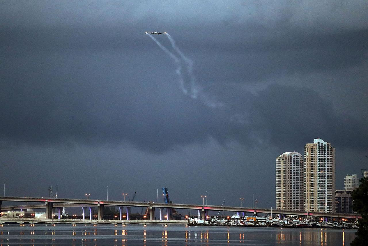 <p>A plane sprays pesticide over parts of the city of Miami in the hope of controlling and reducing the number of mosquitos, some of which may be capable of spreading the Zika virus on Aug. 12, 2016 in Miami, Fla. (Joe Raedle/Getty Images)</p>