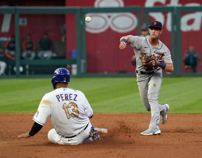 Tigers shortstop Zack Short throws over Royals catcher Salvador Perez as he tries to turn a double play in the fourth inning on Friday, July 23, 2021, in Kansas City, Missouri.