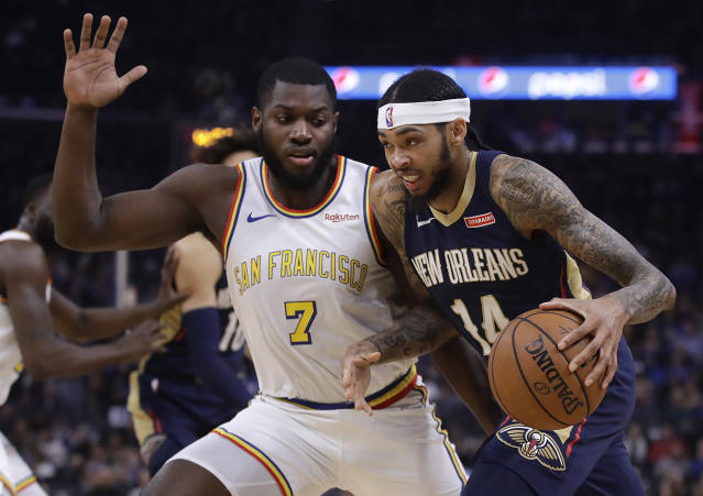 New Orleans Pelicans' Brandon Ingram, right, drives the ball against Golden State Warriors' Eric Paschall (7) during the first half of an NBA basketball game Friday, Dec. 20, 2019, in San Francisco. (AP Photo/Ben Margot)