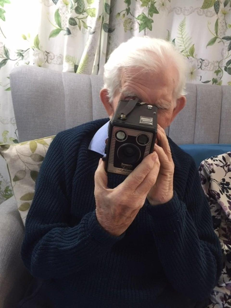 A care home resident using a camera from one of the memory boxes (Wessex Heritage Trust/PA).