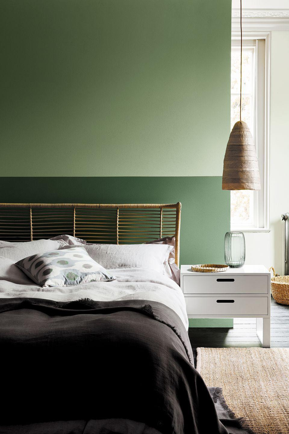 <p>Why settle for one paint color when you can choose two, right? This green two-tone wall, featuring different color weights, adds personality to this bedroom. </p>