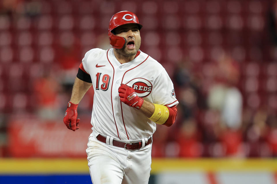 Cincinnati Reds' Joey Votto reacts as he runs the bases after hitting a two-run home run during the third inning of a baseball game against the Pittsburgh Pirates in Cincinnati, Monday, Sept. 20, 2021. (AP Photo/Aaron Doster)