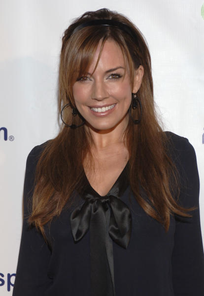 FILE - In this Oct. 11, 2006 file photo, actress Krista Allen attends the One Community, One Cause evening to create awareness and relief for the people of Darfur presented by MySpace.com in Beverly Hills, Calif. George Clooney, 52, Hollywood's most determined bachelor famous for a litany of fleeting loves, including Allen, has taken himself off the romantic market and proposed to 36-year-old attorney Amal Alamuddin. A spokesman for the Oscar-winning actor and producer did not respond to requests for comment Monday, April 28, 2014. (AP Photo/Phil McCarten, file)