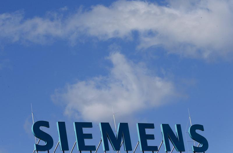 Company logo of Siemens AG is pictured atop office building in Berlin