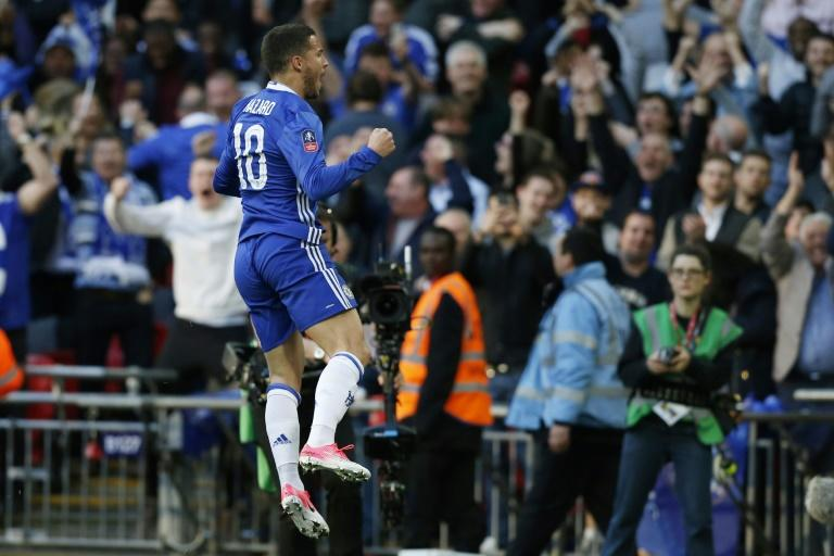 Eden Hazard celebrates scoring Chelsea's third goal during their FA Cup semi-final football match against Tottenham Hotspur at Wembley stadium in London on April 22, 2017