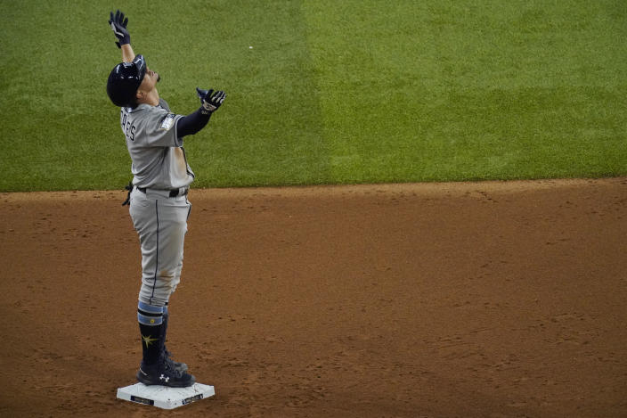 Tampa Bay Rays' Willy Adames celebrates after a double against the Los Angeles Dodgers during the seventh inning in Game 2 of the baseball World Series Wednesday, Oct. 21, 2020, in Arlington, Texas. (AP Photo/Sue Ogrocki)