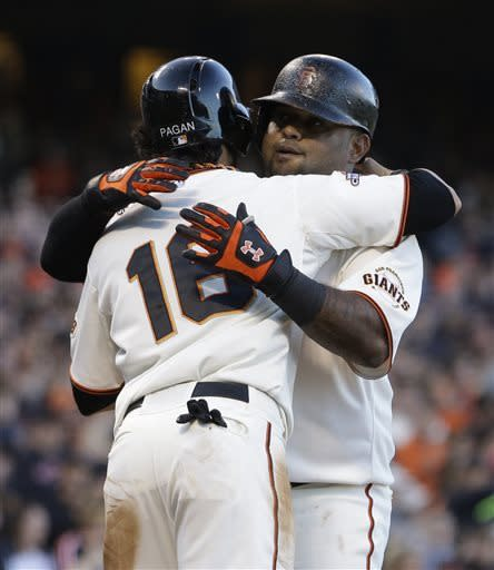 San Francisco Giants' Pablo Sandoval, right, is embraced by Angel Pagan (16) after Sandoval hit a two-run home run off San Diego Padres' Andrew Cashner in the fourth inning of a baseball game Saturday, April 20, 2013, in San Francisco. (AP Photo/Ben Margot)