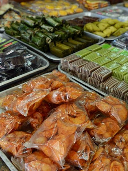 Fresh local snacks are displayed at a vendor's stall in Jakarta on November 28, 2014
