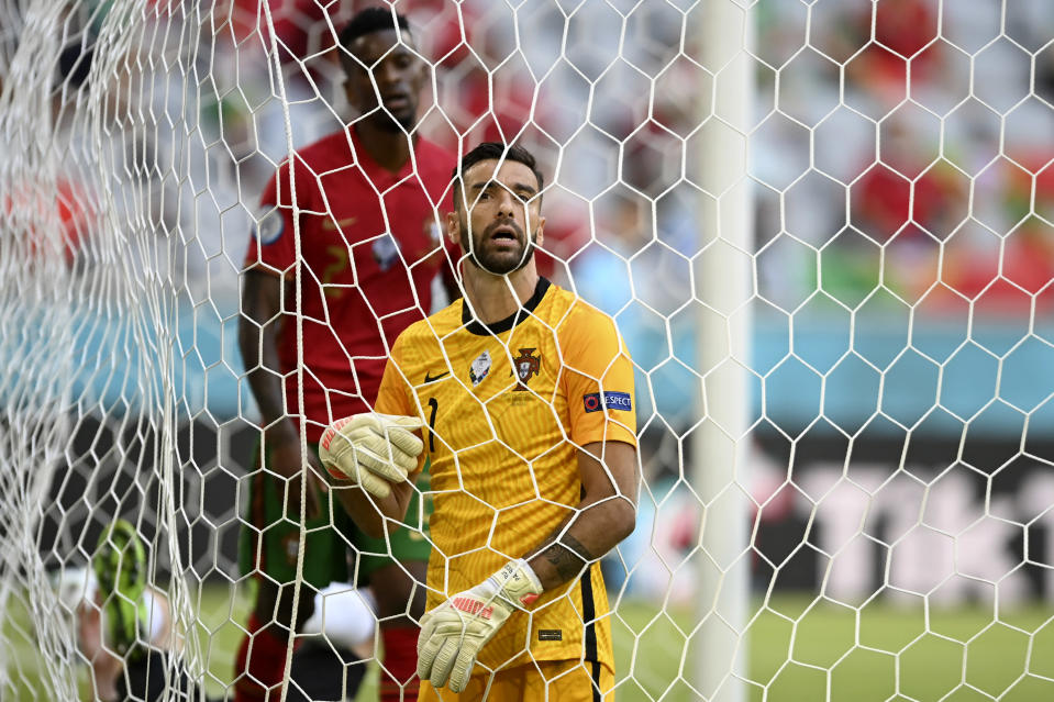 Portugal's goalkeeper Rui Patricio reacts after Germany scored their fourth goal during the Euro 2020 soccer championship group F match between Portugal and Germany at the Football Arena stadium in Munich, Germany, Saturday, June 19, 2021. (Philipp Guelland/Pool via AP)