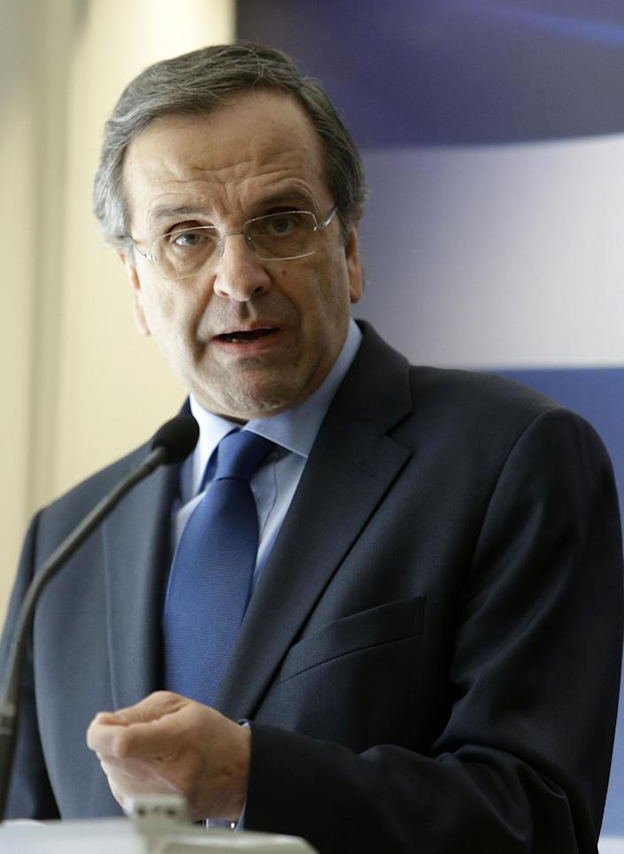 Greece's Prime Minister Antonis Samaras makes a statement to the media at the Finance Ministry in Athens, on Tuesday, March 18, 2014. Greece says it has reached an agreement with its international debt inspectors that will allow the release of a long-delayed rescue loan installment. Samaras said Tuesday that the agreement does not include the requirement for any new austerity measures. Finance Minister Yannis Stournaras said the text of the deal was being written up. (AP Photo/Thanassis Stavrakis)