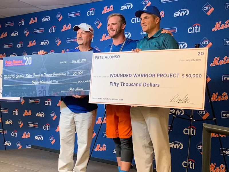 Home Run Derby champ Pete Alonso presents $50,000 checks to the heads of the Wounded Warrior Project and Tunnel to Towers foundations.