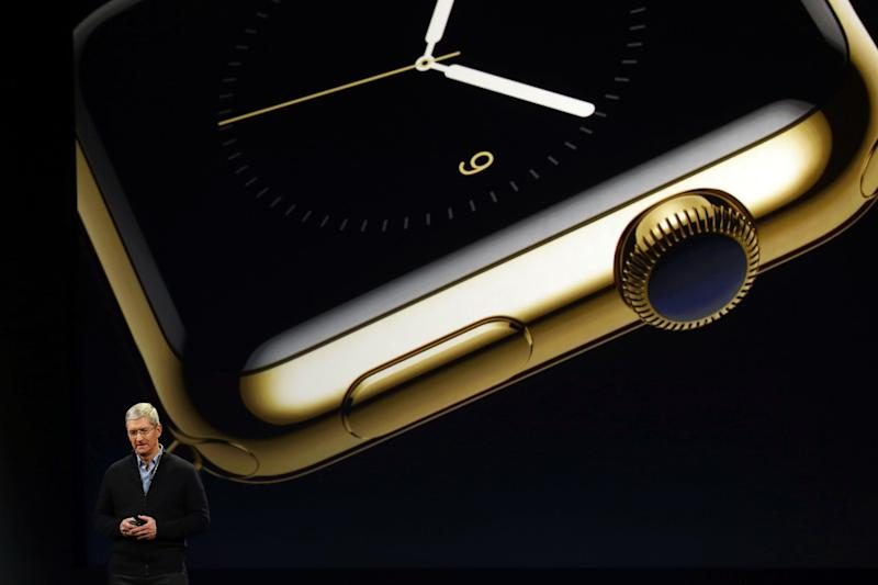 Apple CEO Tim Cook announces the Apple Watch during an Apple special event at the Yerba Buena Center for the Arts on March 9, 2015 in San Francisco, California. Apple Inc. is expected to unveil more details on the much anticipated Apple Watch, the tech giant's entry into the rapidly growing wearable technology segment. The watch displayed behind him is the gold Watch Edition model.