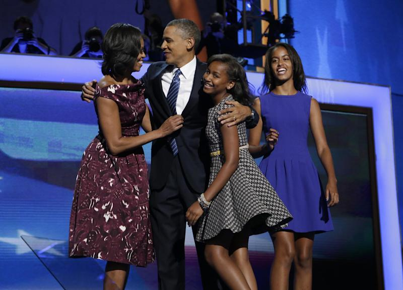 President Barack Obama, left, is joined on stage by first lady Michelle Obama, left, their children Sasha and Malia, right, on the final day of the Democratic National Convention in Charlotte, N.C., Thursday, Sept. 6, 2012.(AP Photo/Charles Dharapak)