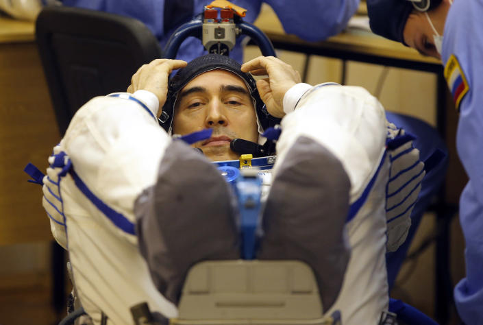 <p>Russian cosmonaut Anatoly Ivanishin, member of the main crew of the expedition to the International Space Station (ISS), gestures while inspecting his space suit prior to the launch of Soyuz MS space ship at the Russian leased Baikonur cosmodrome, Kazakhstan, Thursday, July 7, 2016. (AP Photo/Dmitri Lovetsky) </p>