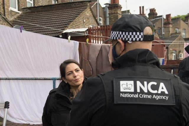 Priti Patel talks to a National Crime Agency officer