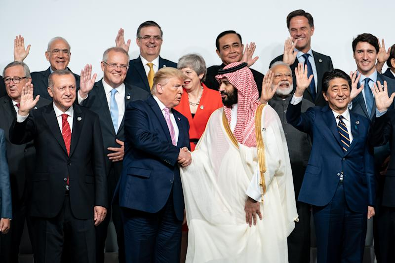 Saudi Crown Prince Mohammed bin Salman and President Donald Trump shake hands as world leaders pose for a photo at the Group of 20 summit in Osaka, Japan, June 28, 2019. (Erin Schaff/The New York Times)