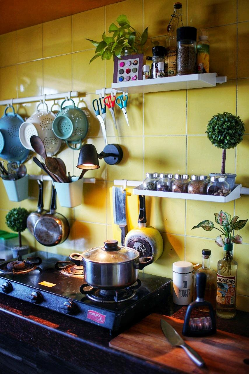The kitchen is where all the magic happens for these two foodies. The original plan included adequate under-counter storage. Bare walls were furnished with functional and aesthetic shelving and hanging units.