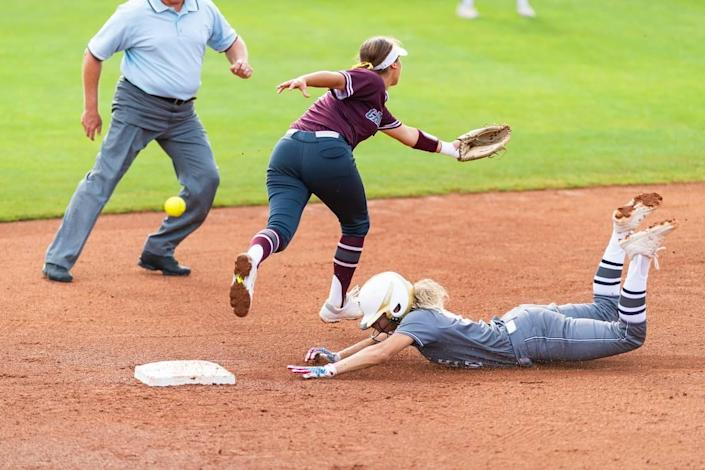 Jayda Coleman steals second and comes around to score after a Calallen error during the 5A state semifinals, Friday May 31, 2019.