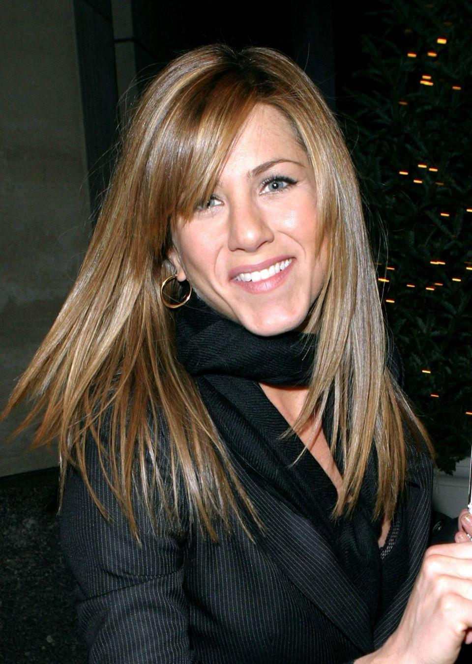 <p>In early 2004, Jen got sleek side bangs to go with her long, straight hair.</p>