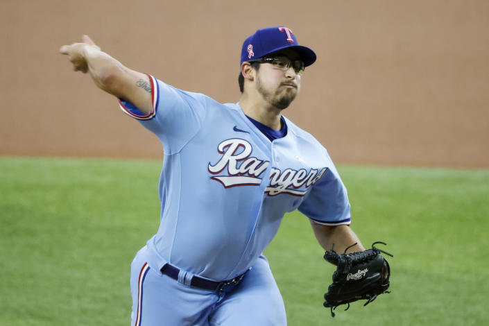 Texas Rangers starting pitcher Dane Dunning throws against the Seattle Mariners during the first inning of a baseball game Sunday, May 9, 2021, in Arlington, Texas. (AP Photo/Michael Ainsworth)