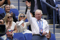 CORRECTS SPELLING TO ROD, INSTEAD OF RON - Former pro tennis player Rod Laver, right, waves to fans during the semifinals of the U.S. Open tennis tournament between Felix Auger-Aliassime, of Canada, and Daniil Medvedev, of Russia, Friday, Sept. 10, 2021, in New York. (AP Photo/Seth Wenig)