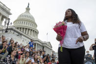 Rep. Cori Bush, D-Mo., speaks to crowds that attended a sit-in at Capitol Hill after it was announced that the Biden administration will enact a targeted nationwide eviction moratorium outside of Capitol Hill in Washington on Tuesday, August 3, 2021. For the past five days, lawmakers and activists primarily led by Rep. Cori Bush, D-Mo., have been sitting in on the steps of Capitol Hill to protest the expiration of the eviction moratorium. (AP Photo/Amanda Andrade-Rhoades)