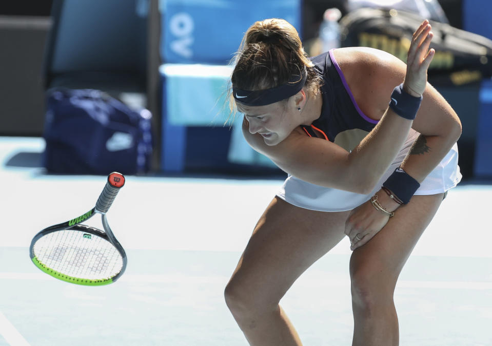Aryna Sabalenka of Belarus throws her racket in frustration during her fourth round match against United States' Serena Williams at the Australian Open tennis championship in Melbourne, Australia, Sunday, Feb. 14, 2021.(AP Photo/Hamish Blair)