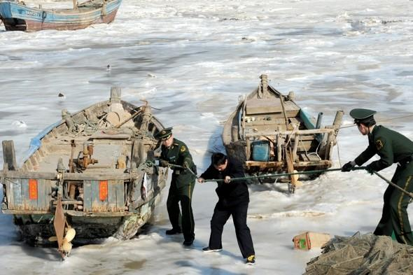 Over 200 boats trapped as sea freezes over in China