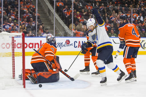 St. Louis Blues' Jaden Schwartz (17) celebrates his goal on Edmonton Oilers goalie Mike Smith (41) as Oilers' Kris Russell (4) and Oscar Klefbom (77) watch during the first period of an NHL hockey game Wednesday, Nov. 6, 2019, in Edmonton, Alberta. (Amber Bracken/The Canadian Press via AP)