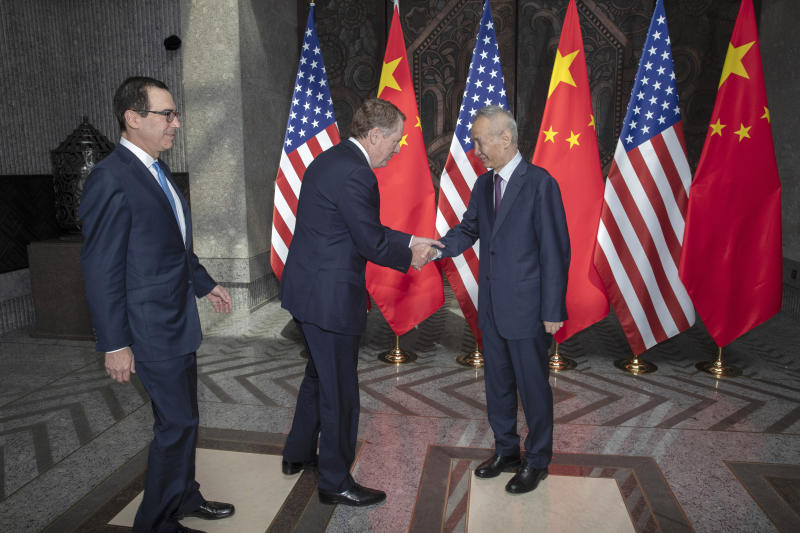CORRECTS SPELLING TO STEVEN INSTEAD OF STEVE -Chinese Vice Premier Liu He, right, welcomes U.S. Trade Representative Robert Lighthizer, center, and Treasury Secretary Steven Mnuchin, left, before holding talks at the Xijiao Conference Center in Shanghai Wednesday, July 31, 2019. (AP Photo/Ng Han Guan, Pool)