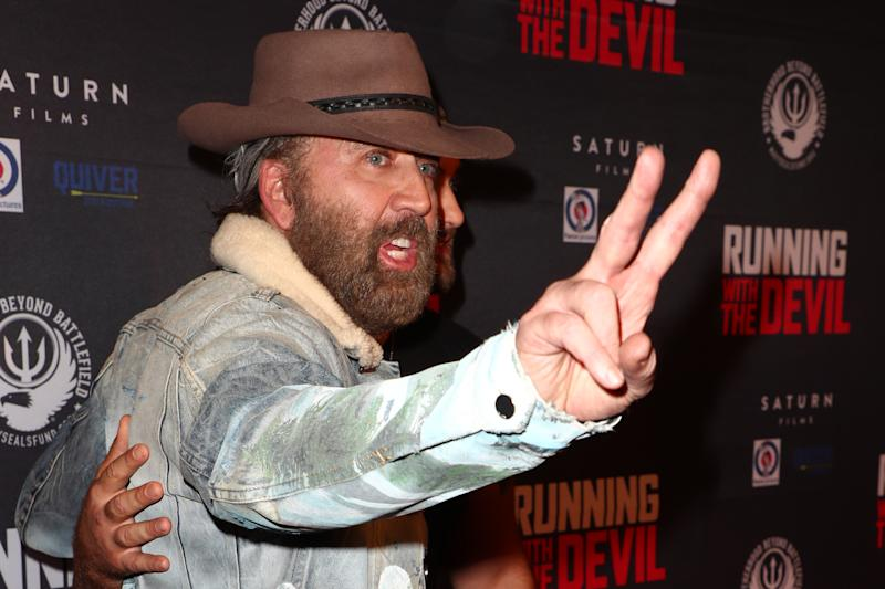 "BEVERLY HILLS, CALIFORNIA - SEPTEMBER 16: Nicolas Cage arrives a tthe Premiere of Quiver Distribution's ""Running With The Devil"" at Writers Guild Theater on September 16, 2019 in Beverly Hills, California. (Photo by Joe Scarnici/FilmMagic)"