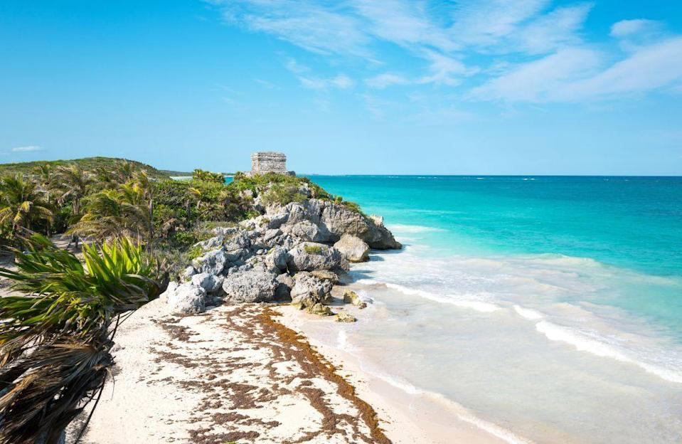 <p>The ancient Mayan ruins overlooking the white sand beaches and bright blue waters of Tulum feel a world away from Cancun, which happens to be just a two hour drive north.</p>
