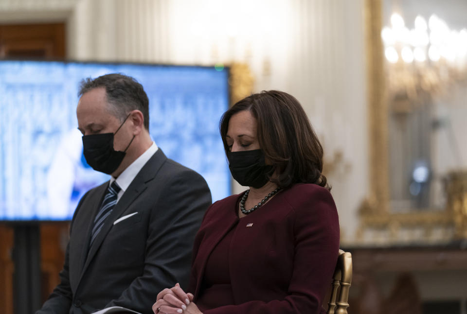 Vice President Kamala Harris, right, and her husband Doug Emhoff, bow their heads in prayer, during a virtual Presidential Inaugural Prayer Service, in the State Dinning Room of the White House, Thursday, Jan. 21, 2021, in Washington. (AP Photo/Alex Brandon)