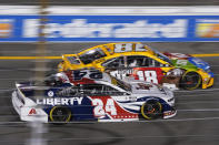 William Byron (24) and Kyle Busch (18) race into turn one during the NASCAR Cup series auto race in Richmond, Va., Saturday, Sept. 11, 2021. (AP Photo/Steve Helber)