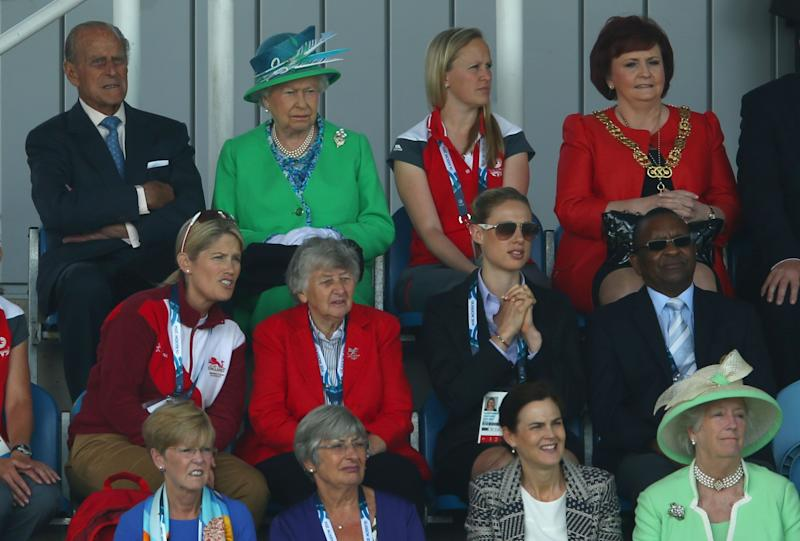 Queen Elizabeth II watches the Women's preliminary match between England and Wales as she visits the Glasgow National Hockey Centre to watch the hockey during day one of the Glasgow 2014 Commonwealth Games on July 24, 2014 in Glasgow, United Kingdom.