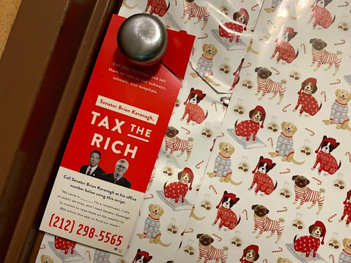 Members of the New York City chapter of the Democratic Socialists of America blanketed key lawmakers' districts with door hangers. (Photo: New York City Democratic Socialists)