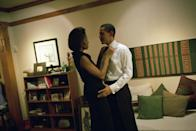 <p>When she fussed over his bow tie at their home as Senator Barack prepared to deliver the keynote address at the Chicago Economic Club in December 2004. [Photo: Getty/Charles Ommanney]</p>