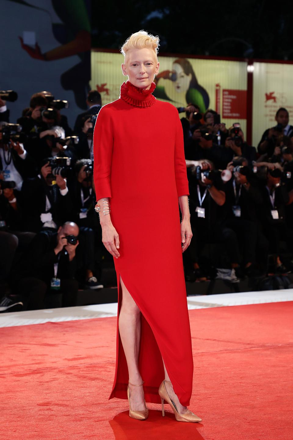 <p>Tilda wore another Haider Ackerman look for red carpet moment, boasting a statement neck and a thigh-high split. </p>