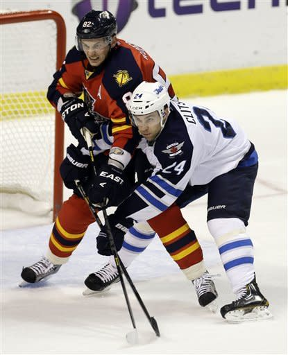 Florida Panthers' Tomas Kopecky (82) and Winnipeg Jets' Grant Clitsome (24) jostle for position in front of the goal during the first period of an NHL hockey game in Sunrise, Fla., Tuesday, March 5, 2013. (AP Photo/J Pat Carter)