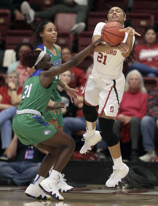 Stanford guard Dijonai Carrington (21) loses the ball next to Florida Gulf Coast forward Nasrin Ulel (31) during the first half of a second-round game in the NCAA women's college basketball tournament in Stanford, Calif., Monday, March 19, 2018. (AP Photo/Jeff Chiu)