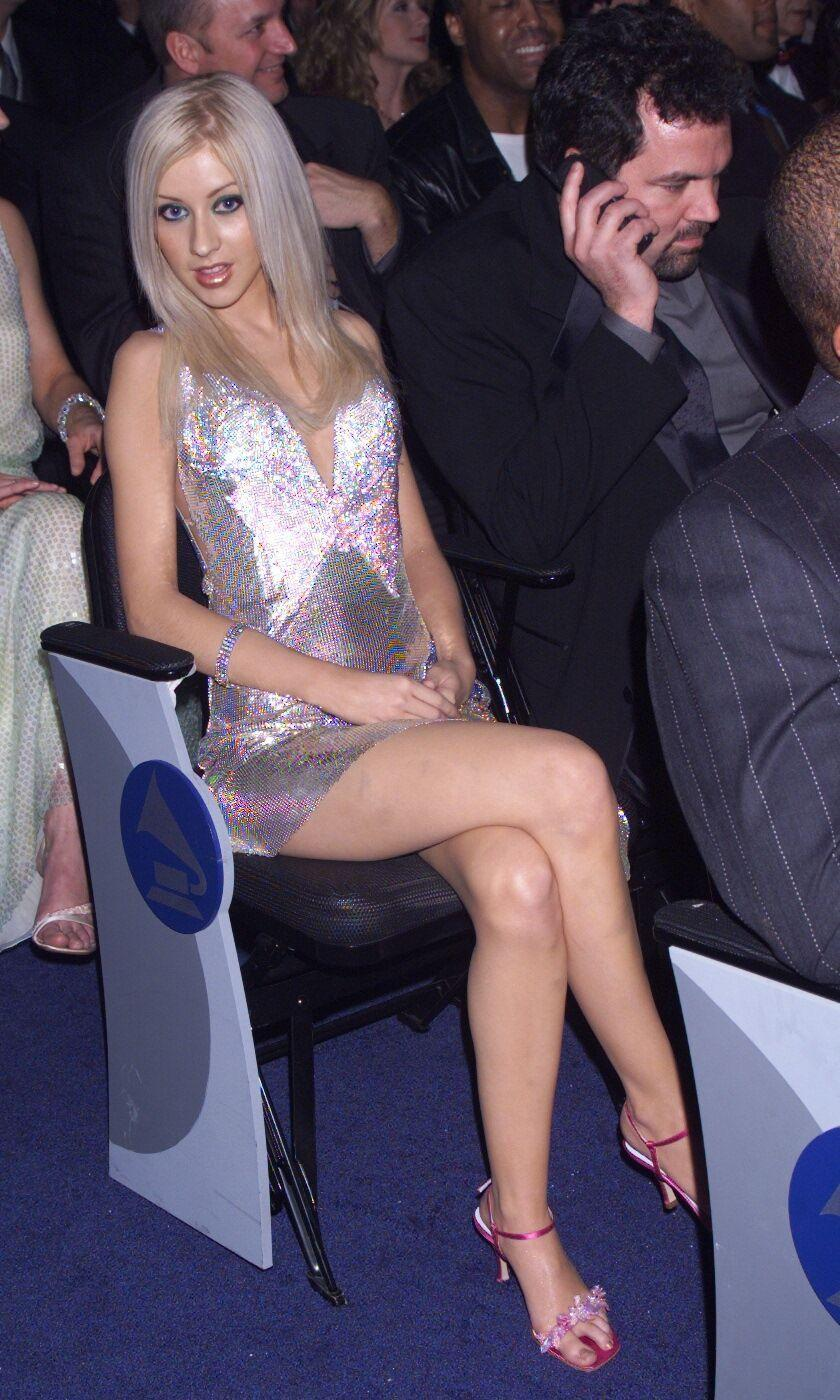 <p>Christina Aguilera—the show's Best New Artist award winner—glimmered in a sparkly Versace minidress with a plunging neckline. Oh, and can't forget the strappy sandals! </p>