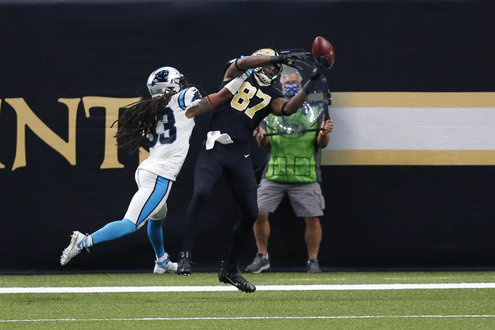 New Orleans Saints tight end Jared Cook (87) pulls in a touchdown reception against Carolina Panthers free safety Tre Boston (33) in the first half of an NFL football game in New Orleans, Sunday, Oct. 25, 2020. (AP Photo/Brett Duke)