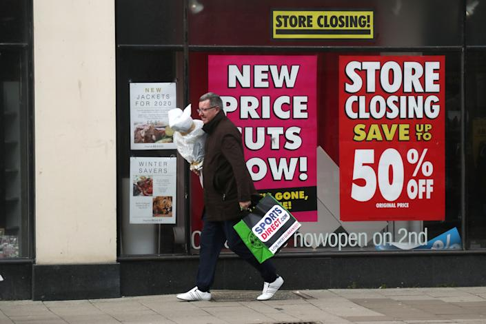 A shopper walks past a high street store that is closing down in Worthing, Britain February 21, 2020. REUTERS/Russell Boyce