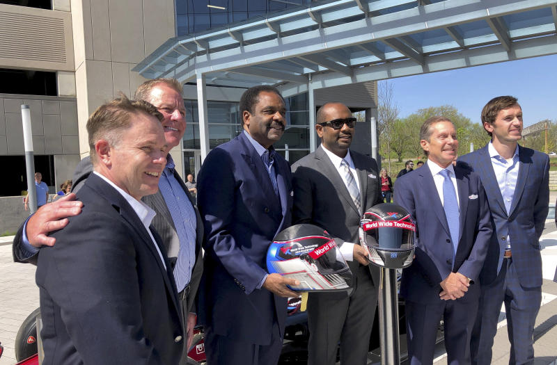 Officials from NASCAR, NHRA and IndyCar pose for a photo in Maryland Heights, Mo., a suburb of St. Louis, Wednesday, April, 17, 2019, after the announcement that Gateway Motorsports Park will be renamed World Wide Technology Raceway at Gateway. Pictured from left, NHRA President Glen Cromwell, IndyCar President Jay Frye, World Wide Technology founder David Steward and his son David Steward II, Gateway Motor Sports CEO Curtis Francois, and NASCAR Managing Director Ben Kennedy. (AP Photo/Jim Salter)